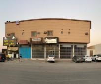 عمارة تقع على تقاطع شارع إبراهيم البرهان، شارع الشرق سابقًا (مساحته 40)